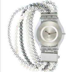 1e767712b4f Swatch watch Pearl Party Skin worlds thinnest watch 5 strings of pearls.  Water resistant 200