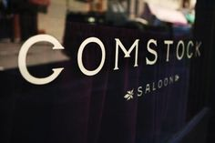 Comstock Saloon sign on window in San Francisco