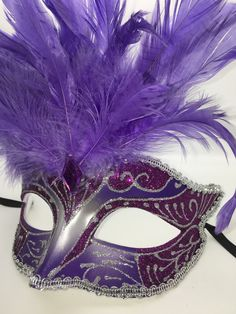 Purple feathers smaller Mardi Gras mask with ribbon ties.