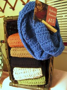 Postcard shows the price and how to wear the infinity scarves folded in the basket