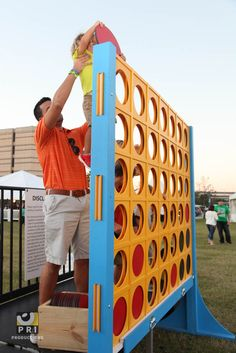 Oversized connect four is fun for all ages and would be a great addition for any outdoor event.