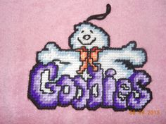 Goodies Ghost Wallhanging in Plastic canvas by SpyderCrafts