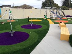 An innovative use of Easy Turf artificial turf safety surfacing under KOMPAN play equipment.   www.kompan.com
