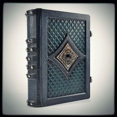 Gothic leather journal... by alexlibris999 on deviantART book journal spellbook equipment gear magic item | Create your own roleplaying game material w/ RPG Bard: www.rpgbard.com | Writing inspiration for Dungeons and Dragons DND D&D Pathfinder PFRPG Warhammer 40k Star Wars Shadowrun Call of Cthulhu Lord of the Rings LoTR + d20 fantasy science fiction scifi horror design | Not Trusty Sword art: click artwork for source
