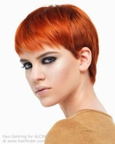 Classic pixie cut with bangs for red hair.