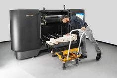The Printer or rapid prototyping system is a computer assisted manufacturing process where software guides the creation of three dimensional models. 3d Printing Business, 3d Printing Industry, 3d Printing Service, 3d Printing Technology, Technology News, Printing Services, Build A 3d Printer, Large 3d Printer, Impression 3d