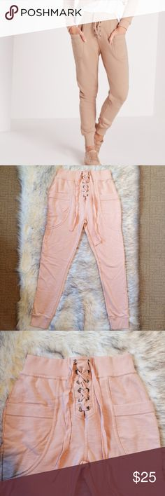 "Lace Up Joggers in Nude Baby Pink 4 Super cute and cozy joggers with lace up detailing and oversized pockets. Ordered online in ""nude"", but ended up being more of a baby pink color. Only worn once, in great condition. Size 4 - fits an XS - S. Missguided Pants Track Pants & Joggers"