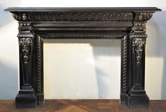 Monumental Napoleon III period fireplace with satyrs heads in Fine Black Belgium marble