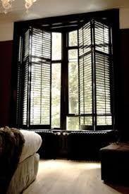 Afbeeldingsresultaat voor zwarte shutters