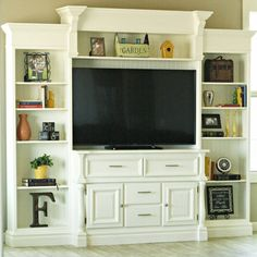 "Find a craigslist dresser and a couple cheap bookcases and you can build a massive entertainment center. Search ""entertainment"" on the blog to learn how."