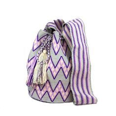 """This #ColombianStyle #handmade #mochila is called """"Color Design"""". One single woman sews it and it takes approximately 25 days to make. The design is at the bag of the mochila with grey, dark purple, light purple and bone thread colors. The strap is thick with the same colors.  Colombian Style offers you #vibrant colors and beautiful patterns that represent the universe and nature. This bags is a #unique piece of #art."""