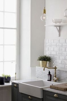 Gosh that's good. Grey and brass... fabulous colors... that white subway tile is perfection... those hanging lights - perf.