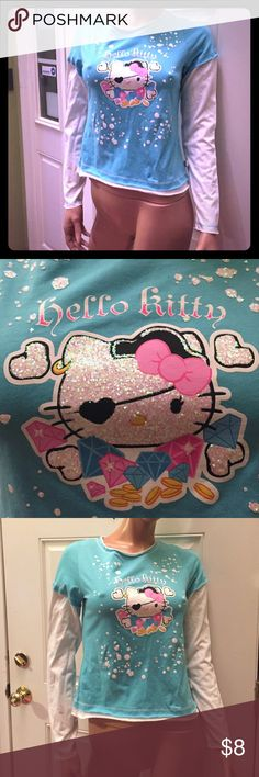 Sanrio hello kitty blue XL pirate girl XL t shirt Sanrio hello kitty blue white long sleeve glitter pirate t shirt girls size XL will fit a small woman Hello Kitty Shirts & Tops Tees - Long Sleeve