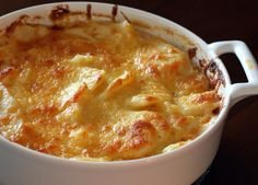 Here's a flavorful scalloped potato dish or potato gratin with Cheddar cheese and a creamy sauce. Cheddar scalloped potatoes, an easy and great tasting side dish to make for any meal or potluck.