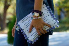 Grey Rain 9x7 cotton pouch with purple pompoms (blue zipper). $40.00, via Etsy.