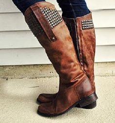 brown leather riding boots with studs on the upper cuff