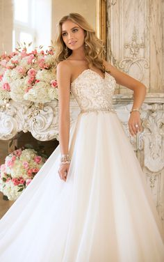 Glitz, glam and gold accents adorn this beautiful Stella York princess wedding dress! (Style 5889)