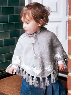 FREE PATTERN:  This hooded poncho, is the perfect gift for children as it's decorated with cute farmyard animals, including a bunny!  Designed by Martin Storey, knitted in Cashsoft DK this free pattern was originally featured in Classic Babies, and is from the Rowan Archive.