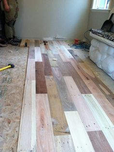 Family took wooden pallets and turned them into hardwood floors. A long project, but it would be totally worth it. Genius. See the finished results!