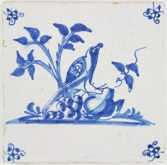Antique Dutch Delft tile in blue with a bird and fruits, 17th century