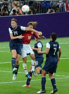 USA forward Abby Wambach goes up for a header with Japan midfielder Homare Sawa during the women's soccer gold medal match at Wembley Stadium.