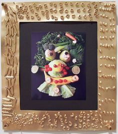 Photo of actual food assemblages a la Archimboldo mounted on gilded cardboard, macaroni, and bean frame.  Cedarhurst Museum of Art: Children's Workshop