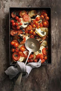 Tomato and feta bake/Barbara Joubert 4 servings      3 onions      60ml olive oil      salt and freshly ground black pepper      5 great rosa tomatoes      400 g feta cheese      handful of fresh basil, grofgebreek      300g cherry tomatoes on the vine