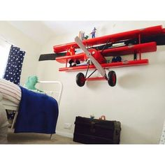Amazing book Shelves Plane wall shelving Replica airplane Red baron model shop, cool aircraft store for A big red baron replica kits the fokker Wall Shelving Units, Wall Bookshelves, Wall Shelves, Book Shelves, Airplane Decor, Airplane Nursery, Airplane Lights, Retro Furniture, Kids Furniture