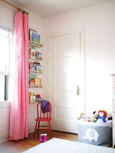Modern Nursery - love the use of a very small wall space to store books in IKEA spice racks