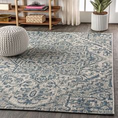 With its star-inspired medallion, this borderless rug adds dreamy Bohemian style to an outdoor porch or patio. Varied tones of red and rust on a mingled gray background give this rug a hand-woven, vintage vibe. The flatweave design is great for high-traffic spaces indoors too.