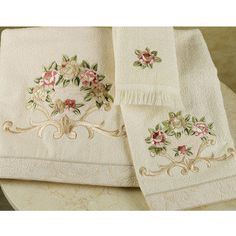 Rosefan Embroidered Bath Towels..my sister in law would love these.