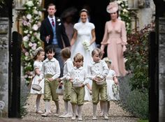Three-year-old Prince George, fourth from left, was one of the page boys. The outfits for the little attendants were made by Pepa