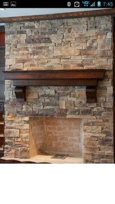 Dark mantle for my fire place... loving the clean modern edges with the traditional stones