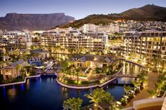 At the One & Only Cape Town, on the Victoria and Albert Waterfront, the African influences have a decidedly urbane feel. With views of Table Mountain, the hotel sits on a man-made lagoon. (via One and Only Cape Town : Daily Escape : Travel Channel) Ansel Adams, Resorts, One & Only, Bali, Cape Town Hotels, V&a Waterfront, Waterfront Property, Honeymoon Spots, Vacation Spots