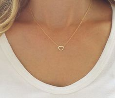 Bring some heart to your next look with our dainty gold necklace, with a stunningly gold filled heart charm. This delicate and dainty necklace is perfect for daytime wear. With its simple, open design, this goldfilled necklace is sure to compliment Small Heart Necklace, Dainty Gold Necklace, Cute Necklace, Dainty Jewelry, Simple Necklace, Heart Pendant Necklace, Simple Jewelry, Heart Jewelry, Jewelry Gifts