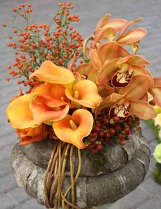 orange calla lily and orchid centerpiece