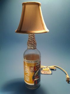 Major Peters® Bloody Mary Mix Liquor Bottle Table Lamp W/ White Shade This is a Quality Handmade Liquor Bottle Table Lamp This liquor bottle lamp is a unique way to light your home, whether on a ta. Bottle Lamps, Bottle Art, Alcohol Lamp, Shop Desk, Bloody Mary Mix, Custom Candles, Liquor Bottles, Fabric Shades, Light Table