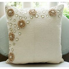 throw pillow for our bed -- make in a really soft peach or pale pink with contrast rosettes