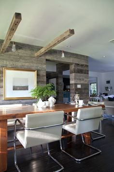 rustic modern dining room. AWESOME wood wall + pendant light feature.