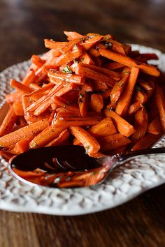 Beautiful roasted carrots with a white wine vinaigrette. Delicious hot, warm, room temp, or cold out of the fridge! These are addictive.