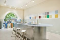 Cover Story plastic-free paint shop encourages visitors to play with colour.