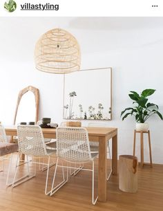 dining room table white wood california bungalow home decor inspo interior design Dining Room Design, Dining Room Table, Dining Rooms, Wicker Dining Room Chairs, Table Lamps, Dining Area, Rattan Pendant Light, Pendant Lamp, Pendant Lighting