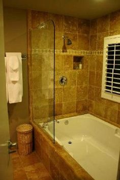Travartine bathroom with tub pictures | Travertine shower/soaking tub in one of the suites