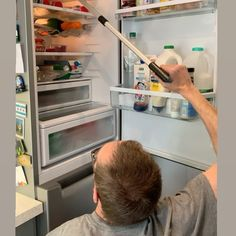 """Vicki T ♿️ on Instagram: """"I took this a couple weeks ago, @mrwobblelegs using his grabber to get hold of something on the top shelf of the worlds tallest fridge. In…"""" Top Freezer Refrigerator, French Door Refrigerator, Tall Fridge, Couple Weeks, Take My, Hold On, Shelf, Instagram, Design"""