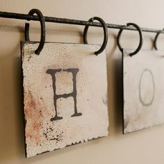 Love these tile letters - on rings to hang on anything - curtain rod? fishing pole?