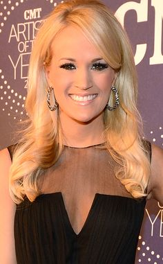 Carrie Underwood arrives at the 2012 CMT Artists of the Year event with soft curls and a slight bouffant. Nude lips and luscious lashes complete her beauty look