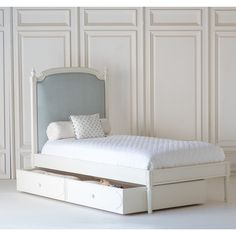 The Lovely Lou Lou Upholstered Child's Bed by The Beautiful Bed Company, is inspired by royalty. It is reminiscent of the French style and boasts an understated elegance. It offers a casual elegance with it's naive hand carving and curved lines on the headboard, finished with four pretty hand carved finials. This bed can be upholstered using one of our fabrics or your own material.