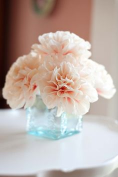 My two favorite colors. Tiffany blue glass vase with soft pinky peach peonies. Simple beauty.