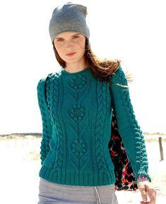 Пуловер с шишечками и косами