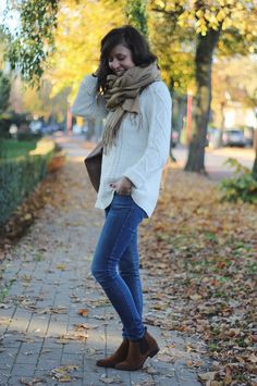 white pattern sweater, light denim jeans, brown Chelsea boots, scarf